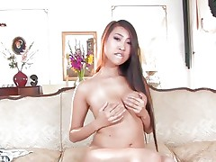 Seductive Sharon Lee plays her her soft round tits