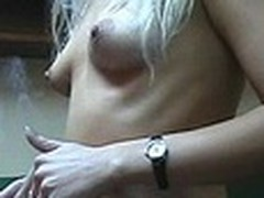 Lecherous blonde babe with small sticking tits walks naked in her room filmed by her boy-friend with amateur cam in his hands. He doesn't like her smoking but really enjoys her hot nude body shyly covered by New Year tree decoration :)