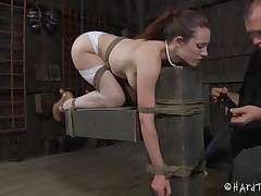 Iona Grace has a beautiful body and how the executor tied her in that position is just wonderful. The sweet milf stays there with a device that keeps her face hole opened but doesn't gags it so that babe can get fingered in that sexy face hole and with her ass up. A metal hook is in inserted in her anus and then she's sex toy fucked