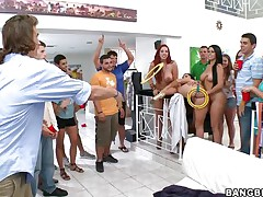 Kelly Divine, Diamond Kitty, and Ashli Orion invade a college dorm for some fun and fucking. Ashli takes a dildo in the ass with Diamond holding it for a game of ring toss. The winner gets to lick Ashli's brown eye, then get his salad tossed, get a blowjob, and fuck a girl anally for the first time.