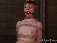 What do we have here? It's the blonde slut Pi, all tied up and still wearing her panties. Some whipping warms her up and then the executor puts clamps on her fragile nipples before cutting a hole in her panties to show us her cunt. Her pussy looks damn fine but it's time to take those panties off and get to business