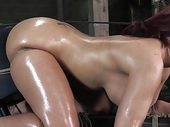 Oiled and tied up our redhead receives a deep mouth fucking from her executor. He is not joking around and gives this whore one hell of a fuck. She sits there tied and with a big rodeo fucking machine under her ass. This voluptuous whore needs to get all her holes fucked and filled with cum!