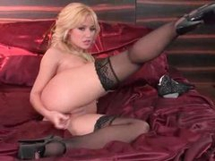 Nice-looking and glamorous golden-haired toy fucks solo